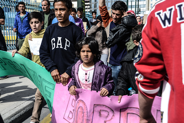 Afghani demonstrating against closed borders in Piraeus