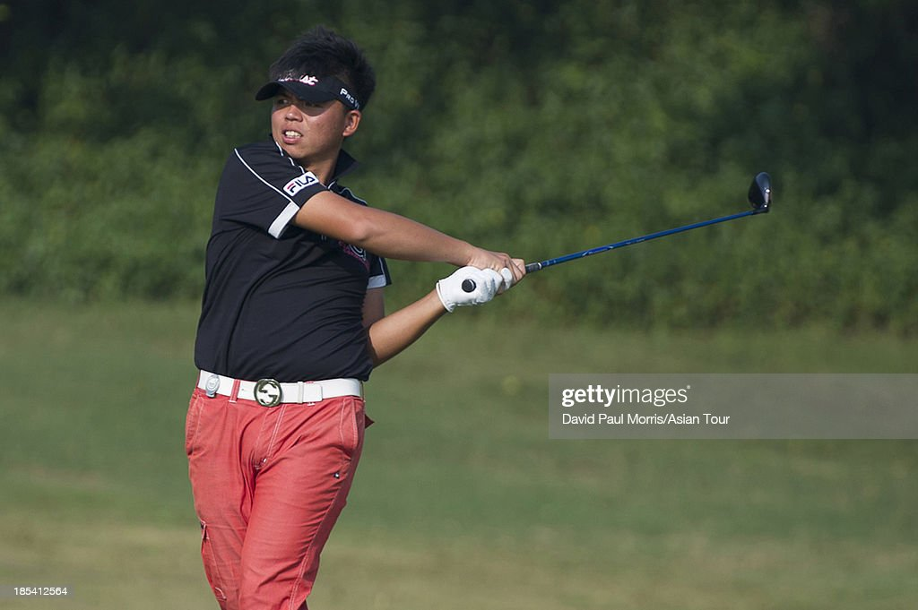 Hung Chien-yao of Chinese Taipei hits his 2nd shot on the 18th hole during round four of the Venetian Macau Open on October 20, 2013 at the Macau Golf & Country Club in Macau. The Asian Tour tournament offers a record US$ 800,000 prize money which goes through October 20.