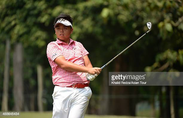 Hung Chienyao of Taiwan plays a shot during round one of the Worldwide Holdings Selangor Masters at Seri Selangor Golf Club on September 18 2014 in...