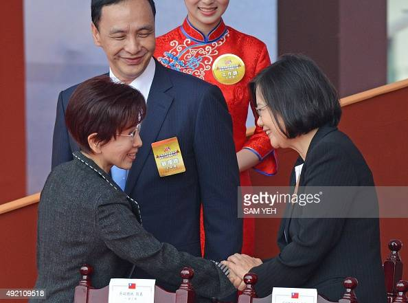 Hung Hsiuchu presidential candidate from the ruling Kuomintang is greeted by Tsai Ingwen chairwoman of Taiwan's main opposition Democratic...