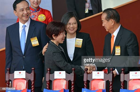 Hung Hsiuchu presidential candidate from the ruling Kuomintang shakes hands with James Soong chairman of the People First Party as Tsai Ingwen...