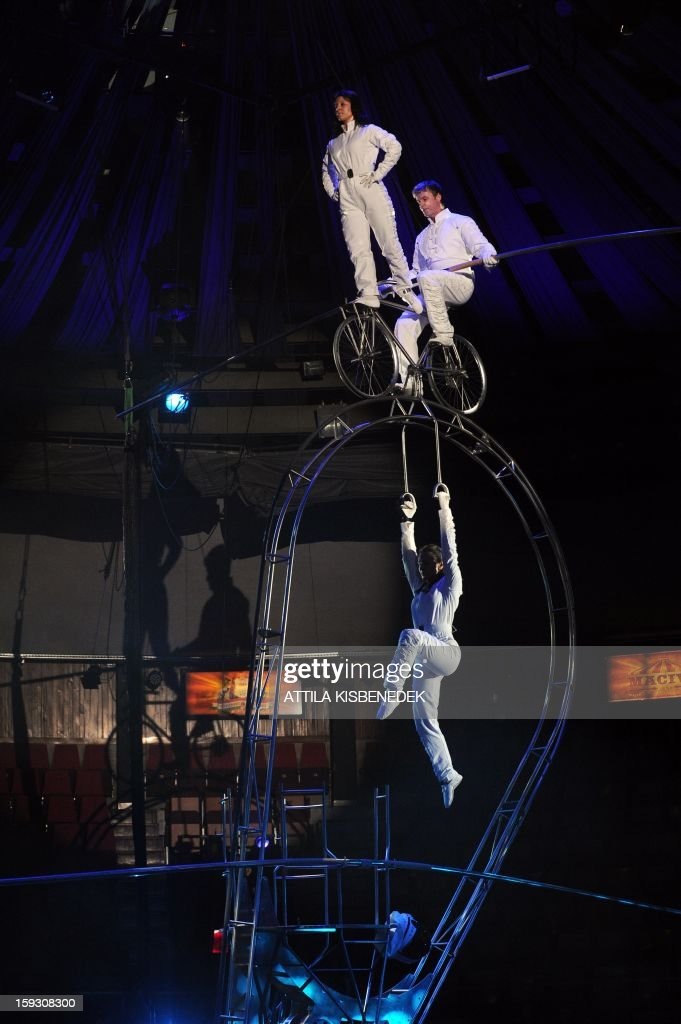 Hungarian acrobat group 'The Arc' performs in the Grand Circus of Budapest on January 11, 2013 during a rehearsal Members of the of a new production, title the 'Hungarian circus stars'. The premiere will be held on January 12.