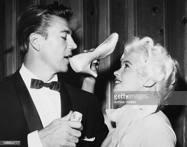 Hungarian actor Mickey Hargitay drinks champagne from the shoe of his bride American actress Jayne Mansfield at their wedding at the Wayfarers Chapel...