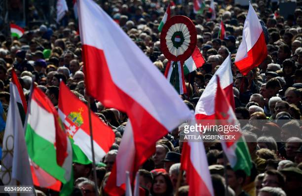 Hungarian and Polish participants listen to the speech of the Hungarian Prime Minister Viktor Orban in front of the National Museum of Budapest on...