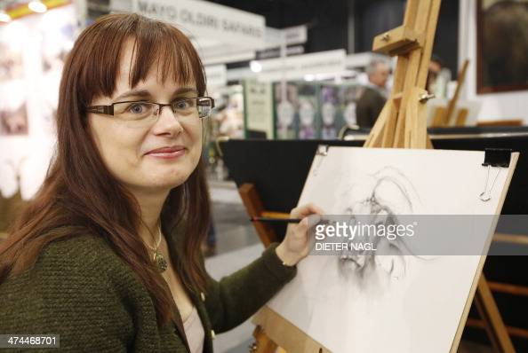 Hungarian artist Judit Prihoda is pictured at the 'Hohe Jagd' hunting fair on February 23 2014 in Salzburg Austria AFP PHOTO / DIETER NAGL