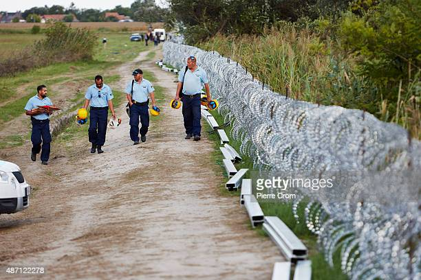 Hungarian authorities build a fence in an attempt to stop migrants from crossing the border from Serbia as they journey into Europe on September 6...