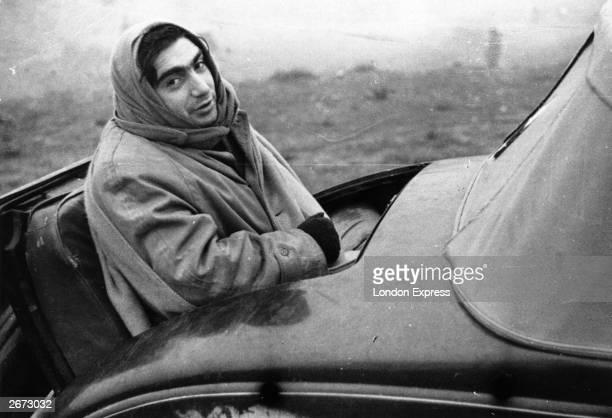 Hungarian born American photojournalist Robert Capa in Spain during the civil war