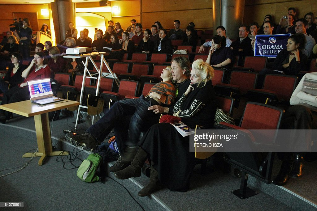 Hungarian citizens and international students watch a live broadcast of the inauguration of President US Barack Obama in the auditorium of Central European University in Budapest on January 20, 2009. Barack Obama took the oath of office to become the first African-American president in US history on January 20 in Washington DC. From Kogelo to London and Basra, millions were glued to television screens as they watched a new era begin in Washington.