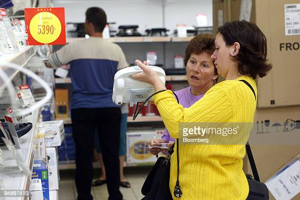 Hungarian consumers shop at French hypermarket Auchan in Budapest Hungary Saturday August 14 2004 Hungary's forint traded close to a 10 day low on...