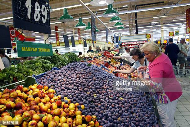 Hungarian consumers shop at French hypermarket Auchan in Budapest Hungary Saturday August 14 2004 The European Commission urged Hungary to make...