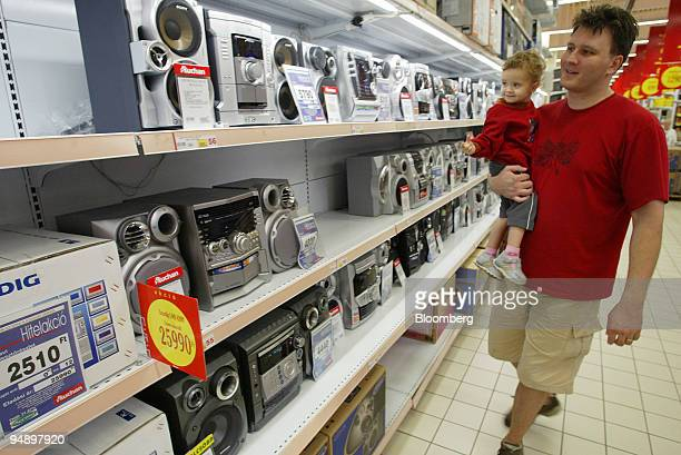 Hungarian consumers shop at French hypermarket Auchan in Budapest Hungary Saturday August 14 2004 The Hungarian forint may decline against the euro...