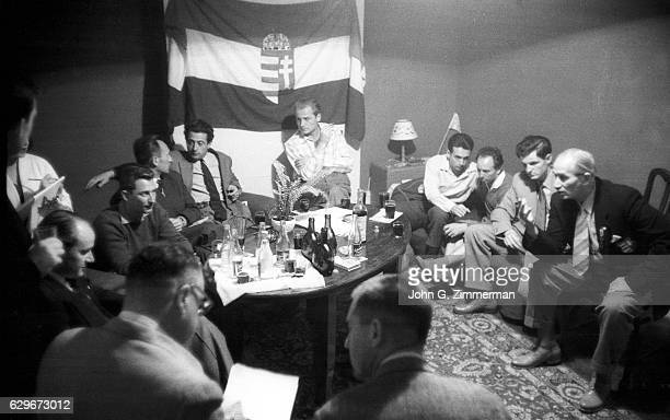 1956 Summer Olympics SI Assistant Managing Editor and Special Correspondent Andre Laguerre at meeting with Hungarian athletes and officials in...