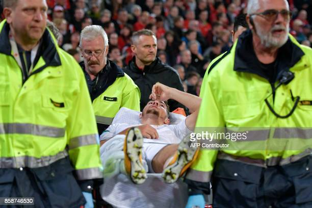 Hungarian defender Barnabas Bese leaves the field after an injury during the FIFA World Cup WC 2018 football qualifier match between Switzerland and...