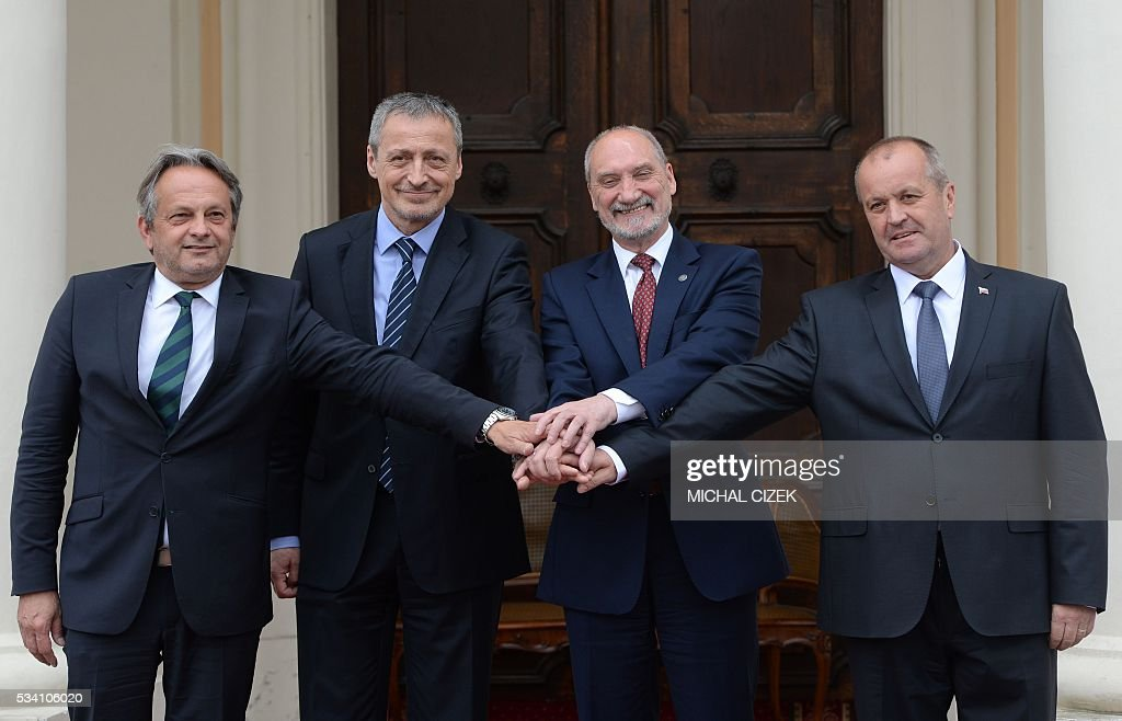 Hungarian Deputy Minister of Defence Tamas Vargha, Czech Republic's Minister of Defense Martin Stropnicky, Polish Defence Minister Antoni Macierewicz and Slovak Defence Minister Peter Gajdos pose for media during the Visegrad Group meeting of the Defens Ministers in Liblice Chateau on May 25, 2016 in Liblice, 50km north of Prague. / AFP / Michal Cizek