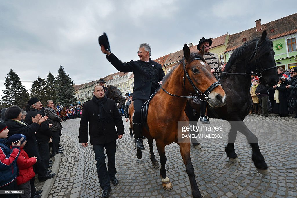 Hungarian Deputy Prime Minister Zsolt Semjen (L) rides a horse during a parade on Hungary's National Day in Targu Secuiesc (250km north of Bucharest) on March 15, 2013. Thousands of ethnic Hungarians from the central Transylvanian region of Romania gather in a celebration in Targu Secuiesc to mark the 1848 Hungarian Revolution.
