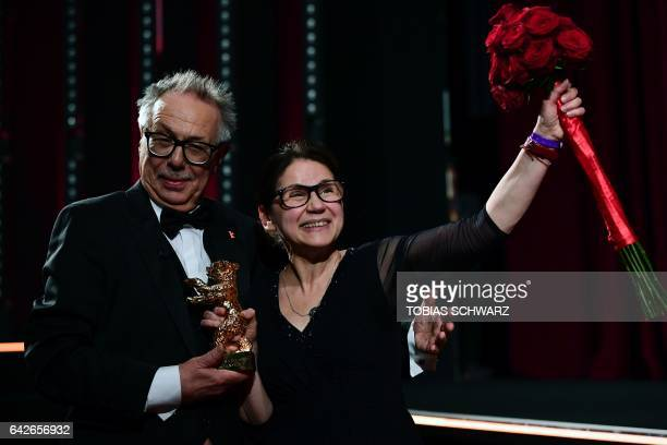 Hungarian director Ildiko Enyedi poses with the Golden Bear for Best Film 'On Body and Soul' and Berlinale Director Dieter Kosslick at the awards...