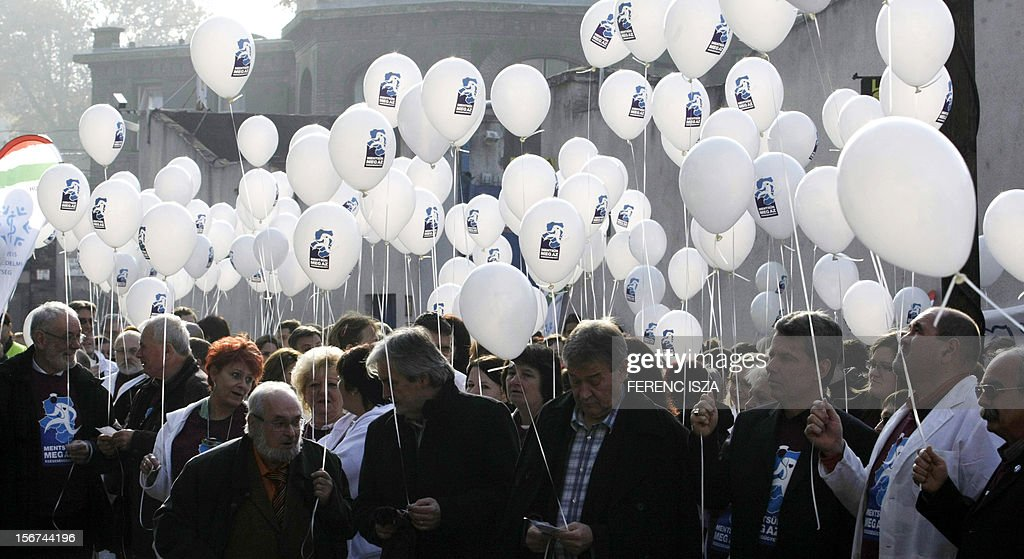 Hungarian doctors and nurses release baloons into the air during a demonstration againts the health politicies of the government in downtown Budapest on November 20, 2012. The health unions in 'Visegrad' countries organised a flash mob at noon this day.