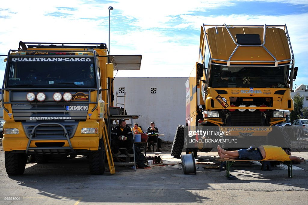 Hungarian driver Miklos Kovacs (R) sleeps under his truck's shadow in the bivouac in Agadir, during a rest day of the second edition of the Africa Eco Race, on Juanuary 3, 2010. The Africa Eco Race started on December 30, 2009 in Nador, Morocco, and continues over 11 days and 6,000 kilometres through Mauritania to lac Rose in Senegal.