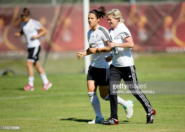 Hungarian Dzsenifer Marozsan and German head coach Silvia Neid are seen during the German national team's training on July 23 2013 before the...