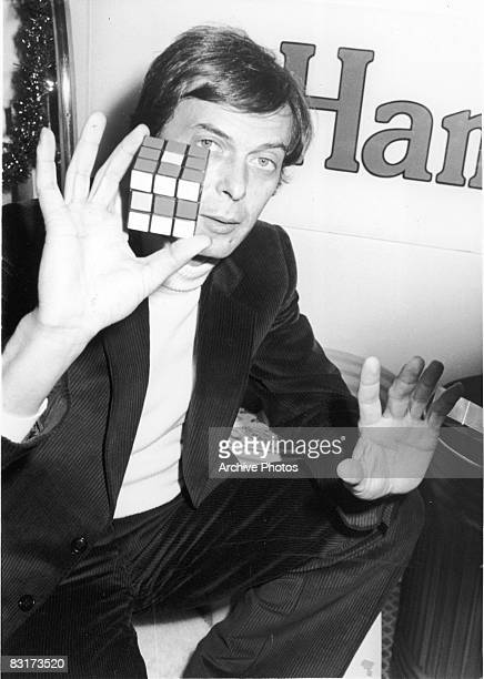 Hungarian educator Erno Rubik holds up his invention the Rubik's cube December 1981