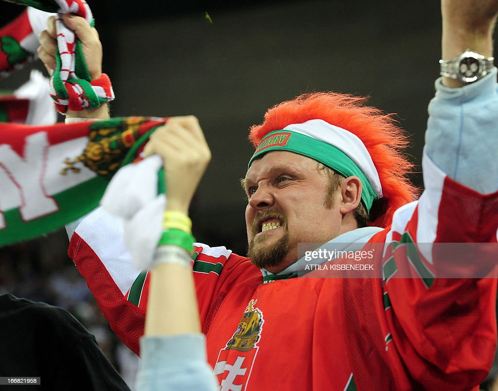 A Hungarian fan celebrates his team's victory after the 2013 IIHF Ice Hockey World Championship Division I Group A match Kazakhstan vs Hungary in 'Papp Laszlo' Arena of Budapest on April 17, 2013. Hungarians won 2-1. AFP PHOTO / ATTILA KISBENEDEK