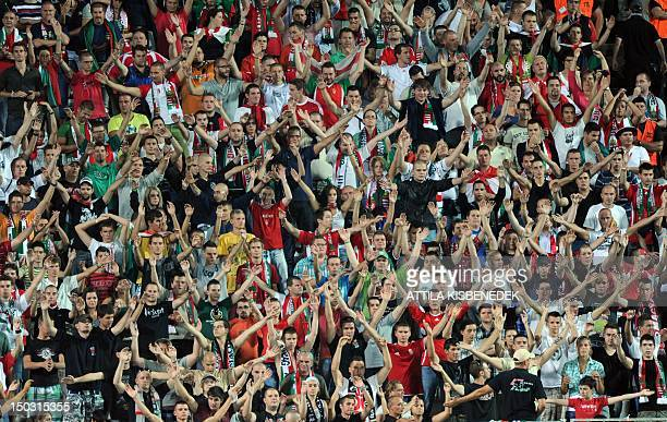 Hungarian fans celebrate their team on August 15 2012 during a friendly football match against Israel at the Puskas Stadium of Budapest in...