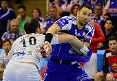 Hungarian Ferenc ILyes of MOLPick Szeged fights for the ball with Macedonian Alem Toskic of HC Vardar in the local sport hall of Szeged on February...