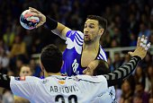 Hungarian Ferenc ILyes of MOLPick Szeged fights for the ball with Macedonian Alem Toskic and Ilija Abutovic of HC Vardar in Szeged on February 28...