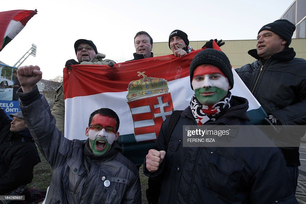 Hungarian football fans gather outside of the Puskas stadium in Budapest on March 22, 2013, prior to the World Cup 2014 qualifying football match between Hungary and Romania. FIFA ordered Hungary to play the 2014 World Cup qualifier match behind closed doors after fans hurled anti-Semitic abuse during a friendly match with Israel in August 2012.