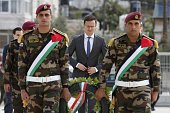 Hungarian Foreign Minister Peter Szijjarto lays a wreath at the tomb of the late Palestinian leader Yasser Arafat at the Muqataa the Palestinian...