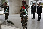 Hungarian Foreign Minister Peter Szijjarto stands after laying a wreath at the tomb of the late Palestinian leader Yasser Arafat at the Muqataa the...