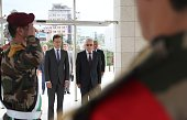 Hungarian Foreign Minister Peter Szijjarto stands in silence after laying a wreath on the tomb of the late Palestinian leader Yasser Arafat at the...