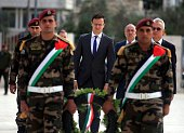 Hungarian Foreign Minister Peter Szijjarto walks before laying a wreath on the tomb of the late Palestinian leader Yasser Arafat at the Mukataa the...