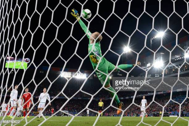 Hungarian goalkeeper Peter Gulacsi fails to stop a goal during the FIFA World Cup 2018 football qualifier match between Switzerland and Hungary at...