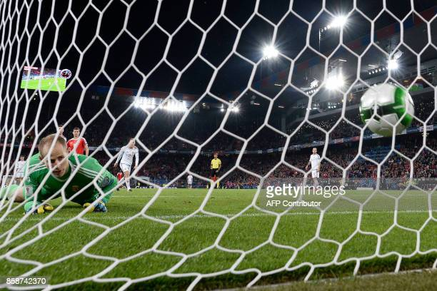 Hungarian goalkeeper Peter Gulacsi receives a goal during the FIFA World Cup WC 2018 football qualifier match between Switzerland and Hungary at the...