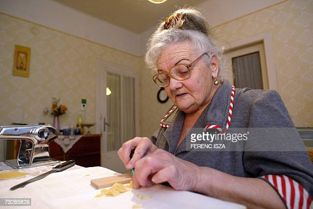 Hungarian Justina Kiss makes pasta while she speaks about the Sarkozy family's life during an interview with AFP in Alattyan 90 kms southeast from...