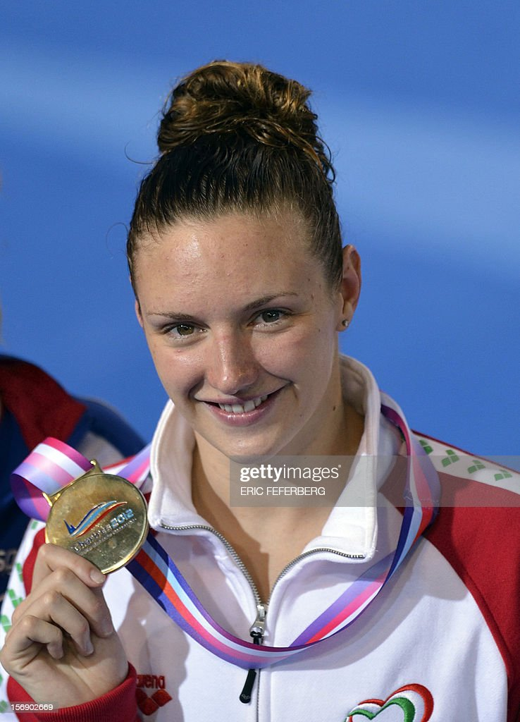 Hungarian Katinka Hosszu displays her gold medal during the podium ceremony for the women's 100m medley event at the European Swimming Championships on November 24, 2012, in Chartres.