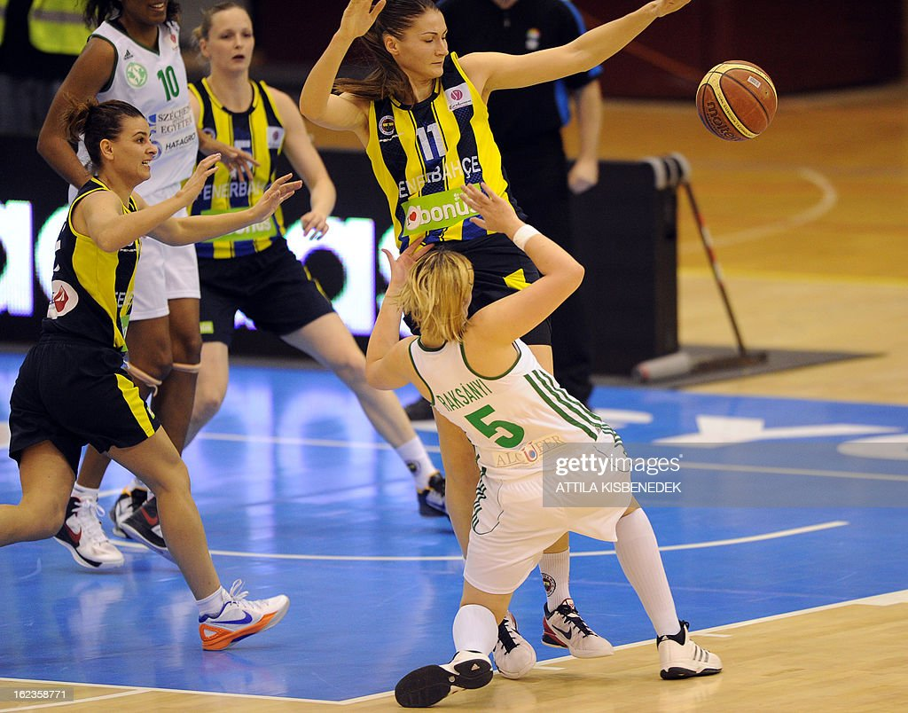 Hungarian Krisztina Raksanyi (R-down) of Hungarian Hat-Agro UNI Gyor fights for the ball with Estonian Anastasiya Verameyenka (Rup) of the Turkish Fenerbahce Istanbul in Gyor on February 22, 2013 during their EuroLeague match. AFP PHOTO / ATTILA KISBENEDEK