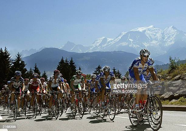 Hungarian Laszlo Bodrogi leads the pack as he rides uphill in front of the Mont Blanc moutain during the eighth stage of the 90th Tour de France...