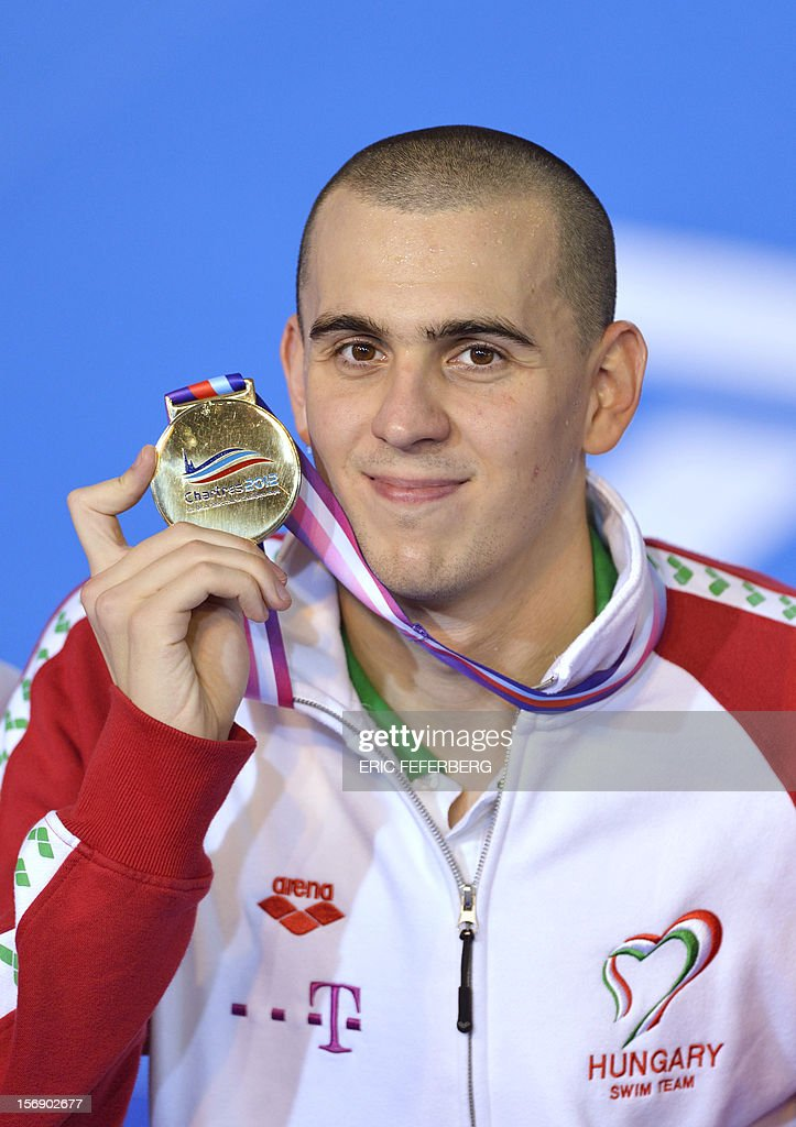 Hungarian Laszlo Cseh displays his gold medal during the podium ceremony for the men's 200m medley event at the European Swimming Championships on November 24, 2012, in Chartres.