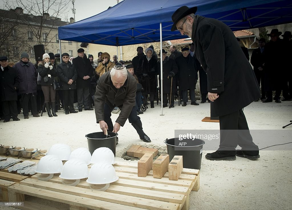 Hungarian leader of the Alliance of Hungarian jewish faith communes Gusztav Zoltai (L) and Andras Kerenyi rabbi placed the foundation-stone of a new synagogue in Csepel in Budapest on January 27, 2013. This synagogue will be the first in the last 80 years in the Hungarian capital.