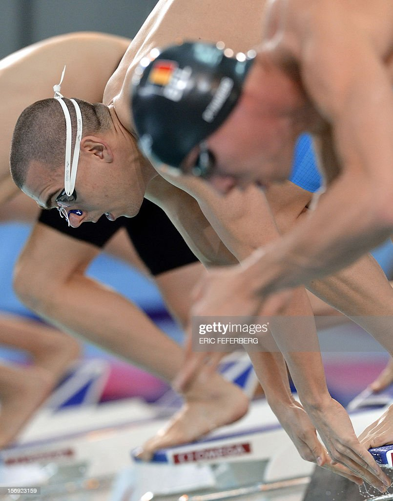 Hungarian Lszlo Cseh (L) takes the start of the men's 200m freestyle race on November 25, 2012 of the European short course swimming championships in the central French city of Chartres.
