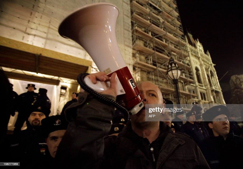A Hungarian man speaks through a megaphone as students demonstrate against the education fee in Budapest, Hungary on December 12, 2012. University students held demonstrations across Hungary to protest higher education reforms including tuition fees approved last week by parliament.