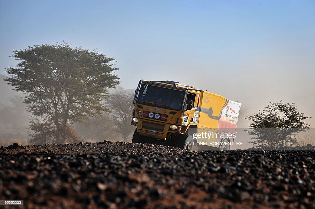 Hungarian Miklos Kovacs drives his Scania during the fourth stage (Mrhimina - Agadir) of the second edition of the Africa Race, on January 2, 2010. The Africa Race started on December 30, 2009 in Nador, Morocco, and continues over 11 days and 6,000 kilometres through Mauritania to lac Rose in Senegal.