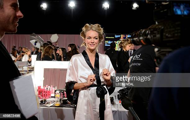 Hungarian model Eniko Mihalik is pictured backstage ahead of the 2014 Victoria's Secret Fashion Show at Earl's Court Exhibition Centre in London on...