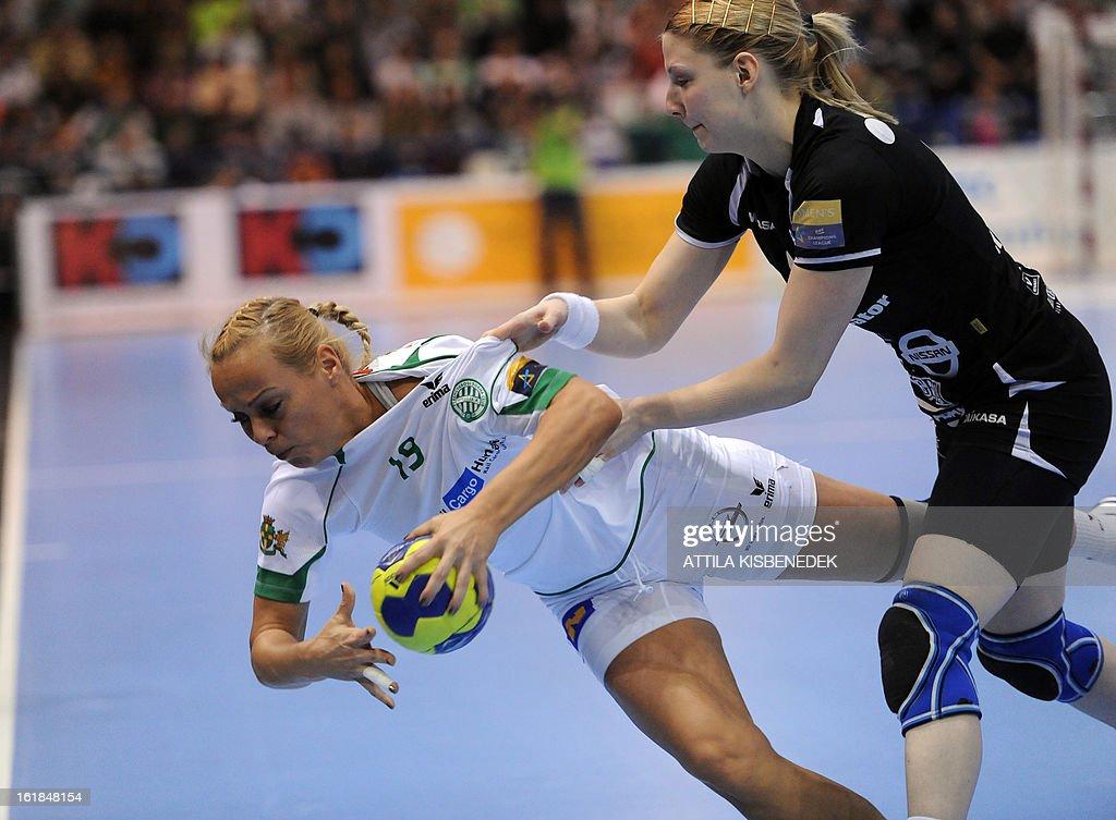 Hungarian Monika Kovacsicz (L) of FTC Rail Cargo Hungaria is fouled by Slovenian Tamara Mavsar (R) of RK Krim Mercator in the local sports hall of Dabas on February 17, 2013 during their EHF Women's Champions League handball match.