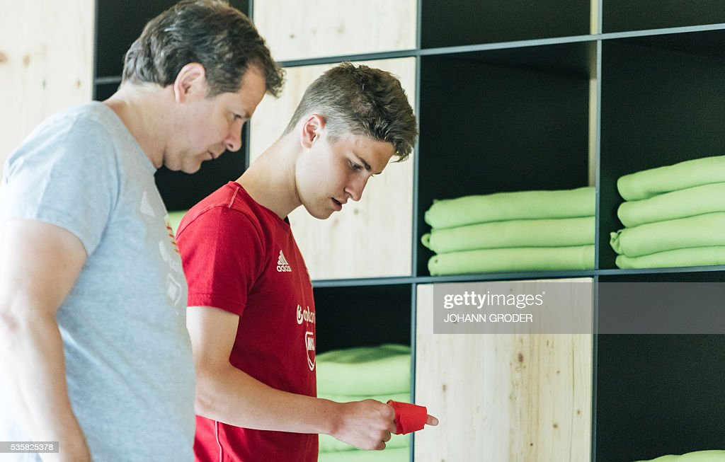 Hungarian national team Assistent Coach Andreas Moeller and Hungarian national team player Roland Sallai attend a training session of Hungarian national football team in Leogang, on May 30, 2016, as part of the team's preparation for the upcoming Euro 2016 European football championships in France. / AFP / APA / Johann GRODER / Austria OUT