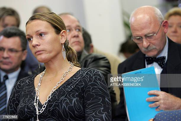 Hungarian Olympic champion Agnes Kovacs who won the the 200meter Breastroke gold medal at the 2000 Sydney Olympics sits with the legal representative...
