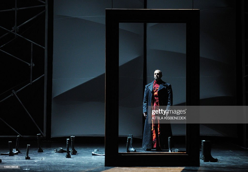 Hungarian opera singer Mihaly Kalmandi performs on stage in Budapest, on January 15, 2013 during a rehearsal of a premiere for 'The Flying Dutchman' of the German composer Richard Wagner, directed by Hungarian Janos Szikora. The premiere will take place on January 19, 2013.