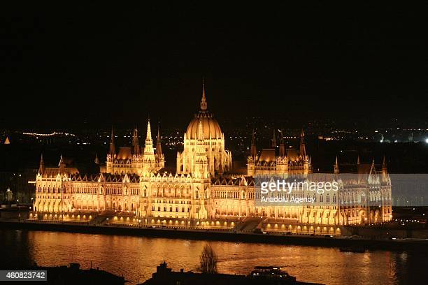 Hungarian parliament building is seen lighted during Christmas celebrations in Budapest Hungary on December 24 2014